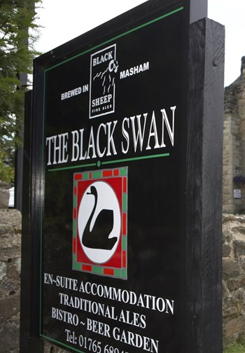 The Black Swan signage