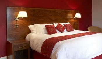 Black Swan hotel headboard and bedside cabinet