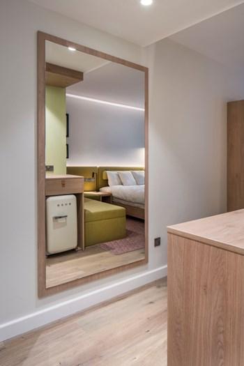 Hampton by Hilton sample bedroom mirror