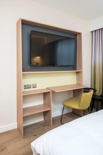 Hampton by Hilton bedroom TV rack and folding desk