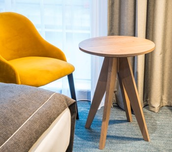 Yellow chair next to a small wooden table