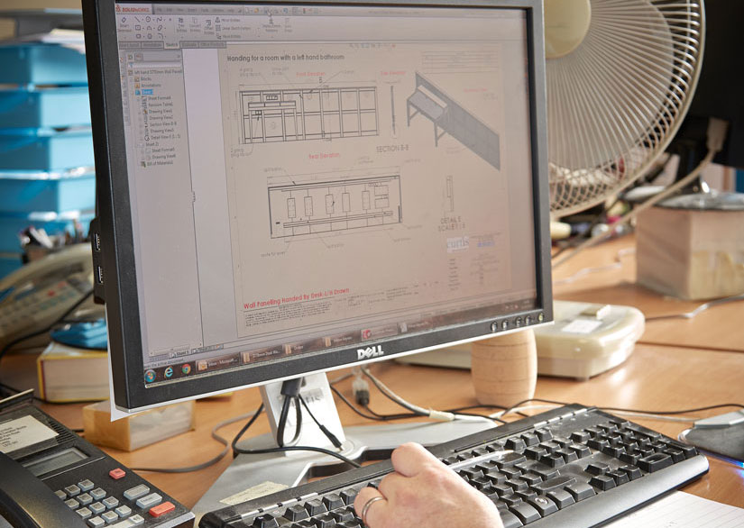 A designer using Solidworks CAD