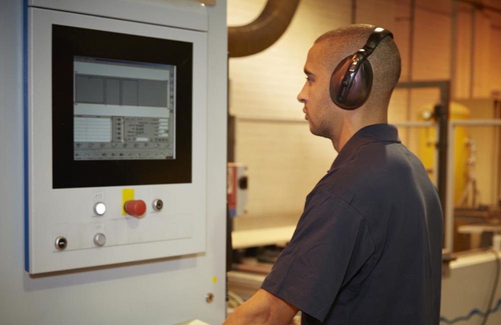 Factory worker using machinery
