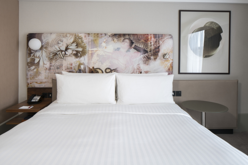 Marriott Kensington upholstered headboard and crisp white bedding