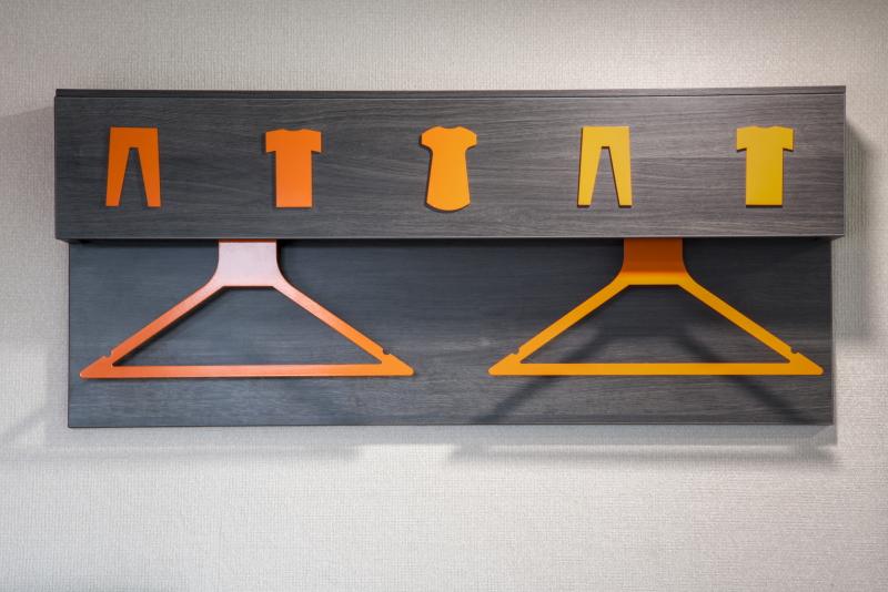 Hanging rail with easyHotel orange hangers